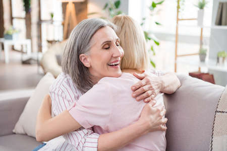 Photo for Photo of happy charming cheerful young woman and old lady hug love family indoors inside house home - Royalty Free Image