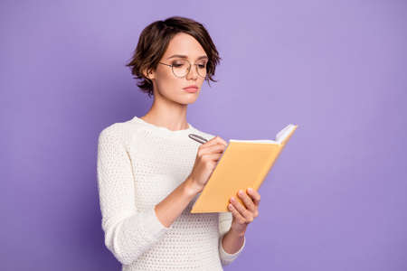 Photo pour Photo portrait of concentrated clever student writing essay in copybook isolated on pastel purple color background - image libre de droit
