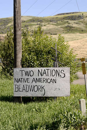 SWEETWATER  / IDAHO STATE/ USA  Tow nations Native American beadwork billboard and  Nez perce indian reservation . 15 July 2010