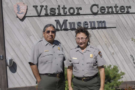 SPALDING / IDAHO STATE/ USA  . Park rangers Kevin Peters and Diane mallikan (mrs) at  Nez Perce  native american history museum stand infron at Visiter Center Musem, Diane explaning to visitors about Nez perce trible history  14 July 2010         (PHOTO B