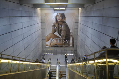 DENMARK / COPENHAGEN _Burberry Body the new fagrance fr women billboard at Kongens Nyrove MNetro comuter train station with Magasin du nord 26 Sept. 2011