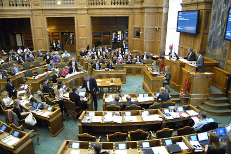 DENMARK / COPENHAGEN _ Newly elected members of daanish parliament reading ext messages ,read newspapers and work on laptops  during debate session in parliament folketinget on first debate day 6 Otc. 2011