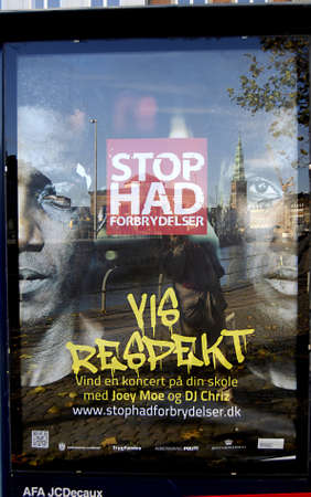 Copenhagen / Denmark.  African faces are used pon  stropmhate crimnialty poster ,the banner is hang at bus stops 6 Nov. 2012