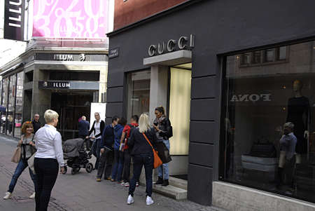 COPENHAGEN /DENMARK-   Gucci shoppers with gucci shopping bags on stroget        26 JUNE 2014