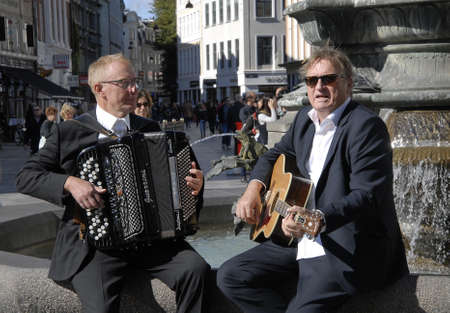 Copenhagen/Denmark/ 07 September   2015_Danish famous TV face and Tv anchor and journalist promote his new music almumb Reimer has wrote text and he his singer partner promoting their music almub at give litte concert at Amager torv today and  forign visi