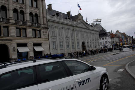 Copenhagen/Denmark/ _ 15th November  2015 _French flag at half mast at french Embassy in Copenhagen and Danish police presentspeople laying lofwers vigils and messages in various language at Frenc Embass in Copenhagen  due tp Paris Terrorist attacked  Fra