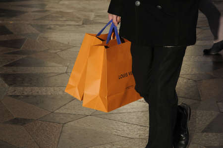 Copenhagen / Denmark_  23Th.December 2016 -   Christmas shopper with Louis Vuitton shopping bags luxury items for christmas celebrations.
