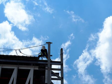 n Working on the Working at height on construction site with blue sky