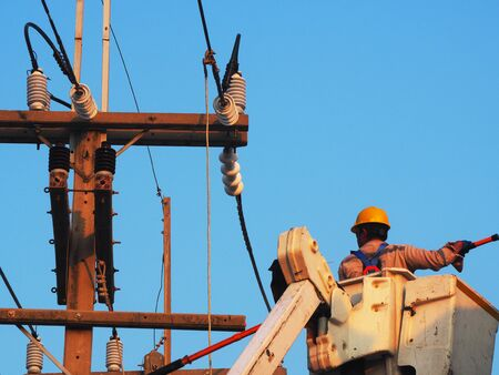 Photo pour electrician man working at height and dangerous ,high voltage power line maintenance - image libre de droit