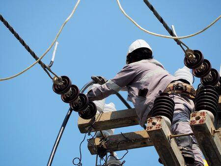 Photo for electrician man working at height and dangerous ,high voltage power line maintenance - Royalty Free Image