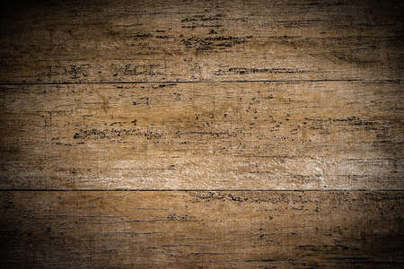 Photo pour Background close-up photos of the texture details of the dark brown wood grain background. Grunge and dirty style with a vignette in the corner of the image and bright spot in the middle . - image libre de droit