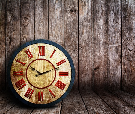Old rusty grunge clock in wooden room