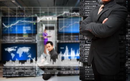 Photo pour Programmer monitoring system in data center room  - image libre de droit