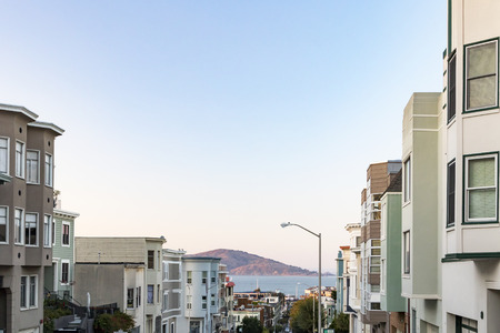 Scenic view of San Francisco bay framed by buildings along Stockton street