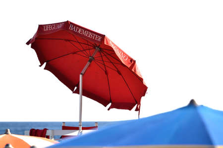 lifeguard umbrella on the beach in front of the sea to shelter from the sun