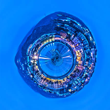 small planet of Varazze, in the Mediterranean Sea, with city lights along the coast illuminating sea water, in Italy