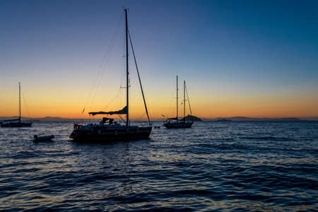 Foto per relaxing and silent sunrise on the sea, on a sailboat - Immagine Royalty Free