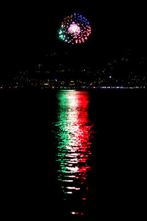 spectacular reflection of a fireworks reproducing the colors of the Italian flag reflecting the light on the sea