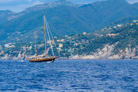 Foto per elegant sailing ship that passes through the Ligurian sea in front of Cinque Terre, Italy - Immagine Royalty Free