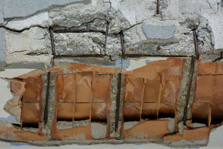 Foto per ruined balcony that is about to collapse with visible construction steel and bricks - Immagine Royalty Free