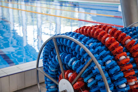 Photo pour Swimming lanes markers in reel storage, near the pool. Pool lane lines for athletics, swimming. - image libre de droit
