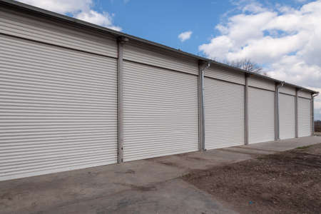 Photo for Storage units with roller shutter doors in industrial area - Royalty Free Image