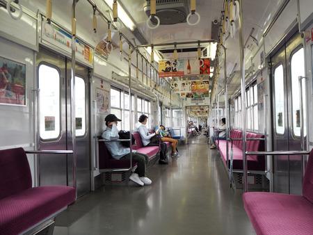Insidea a train in Fukuoka, Japan