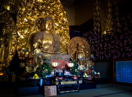 Gold buddha statue of Hase-dera temple in Kamakura, Japan - Sep, 2018.