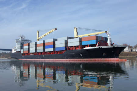 loaded container ship with cranes