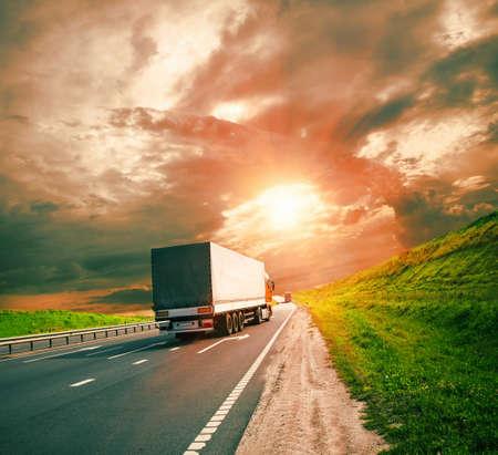 Photo pour trucks under colorful sky - image libre de droit