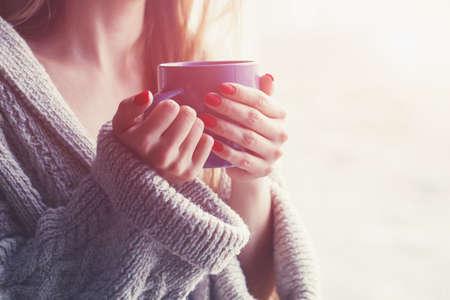 Foto de hands holding hot cup of coffee or tea in morning - Imagen libre de derechos