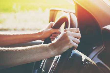Foto de hands on steering wheel driving car - Imagen libre de derechos