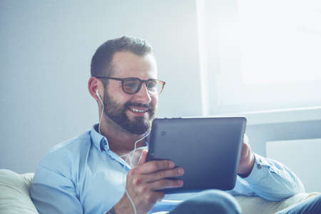 Photo for businessman with digital tablet and earphones - Royalty Free Image