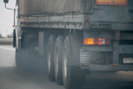 Photo pour Air pollution from truck vehicle exhaust pipe on road, exhaust fumes concept - image libre de droit