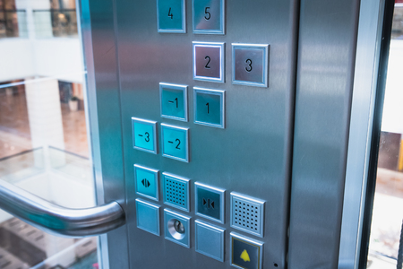 Foto de Elevator buttons control panel in modern business building or Mall or shopping center, close up, toned - Imagen libre de derechos