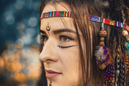 Photo pour Portrait of young girl in image of Native American, close up, young attractive woman warrior, toned - image libre de droit