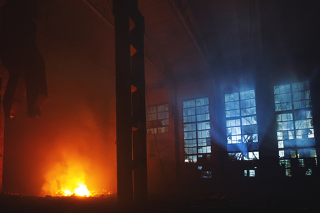 Photo for Fire in factory building at night. Burned by fire industrial warehouse, toned - Royalty Free Image