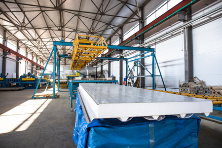 Photo pour Automatic conveyor machinery line or belt for metal roll forming in industrial factory interior as industry background. - image libre de droit