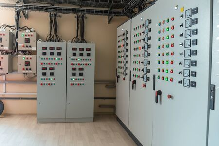 Photo for Electrical switch gear cabinets, control panels in factory. - Royalty Free Image