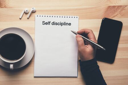 Photo pour Self discipline - text on notepad, female hand with pen ready to write list to do. - image libre de droit
