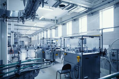 Photo pour Industrial interior of beverage factory, blue toned. Food and drink production manufacturing. - image libre de droit