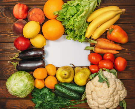 Photo for Healthy Organic Food background with Copy Space. Vegan or Vegetarian Food, Raw Vegetables and Fruits on wooden table, Top View. - Royalty Free Image