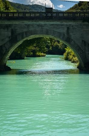 Emerald green waters of the alpine river Soca in Most na Soci ,Slovenia.