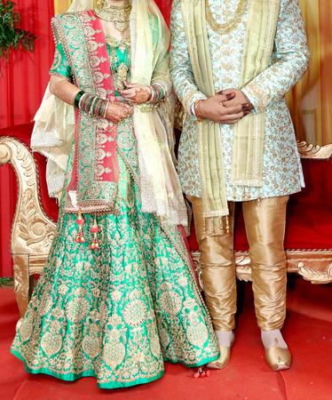 Foto de Indian bride and groom pose for beautiful portraits after their colorful jaimala ceremony ( garlands ceremony ) - Imagen libre de derechos