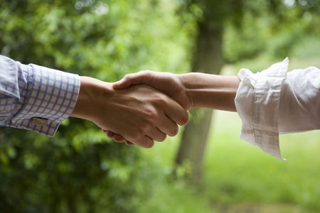 Photo for a relaxed handshake, a businessman in partnership with an artist. - Royalty Free Image