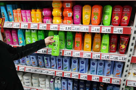 GERMANY - FEBRUARY 2015: Shelves with a variety of Shampoos in a Kaufland supermarket.