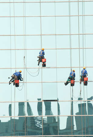 window clean worker on office building