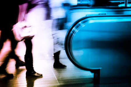 walking business people to elevator blur
