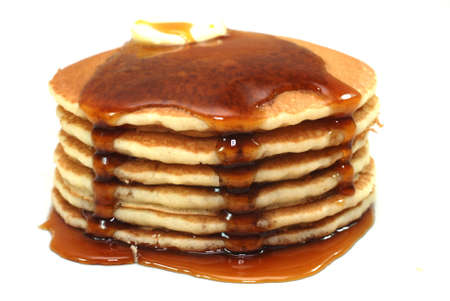 Stack of pancakes and syrup isolated on white background.