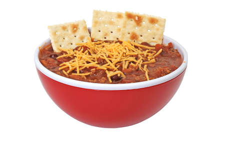 Bowl of hot chili with beans, cheese, and crackers.